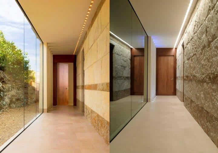 moderne raumgestaltung und einrichtungsidee mit glaswandscheiben und natursteinverkleidung