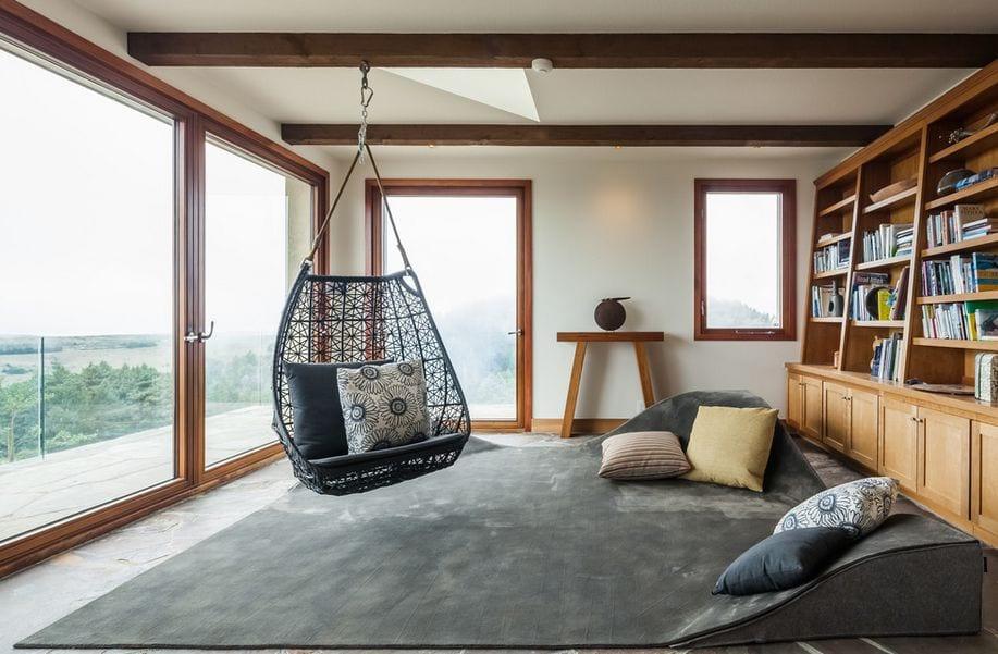 traumteppich grau für minimalistische einrichtung wohnzimmer mit schaukelstuhl grau