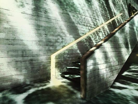 betontreppe mit flachem handlauf aus Holz als idee für modernes interieur design
