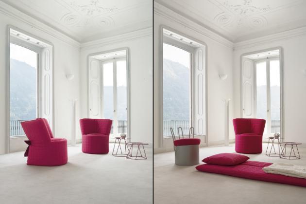 minimalistisches interior design in weiß mit bodenkissen und polstersessel pink