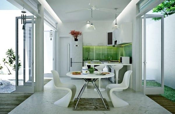 kreative küchenidee für kleine weiße küche mit esstisch rund und akzent in grün