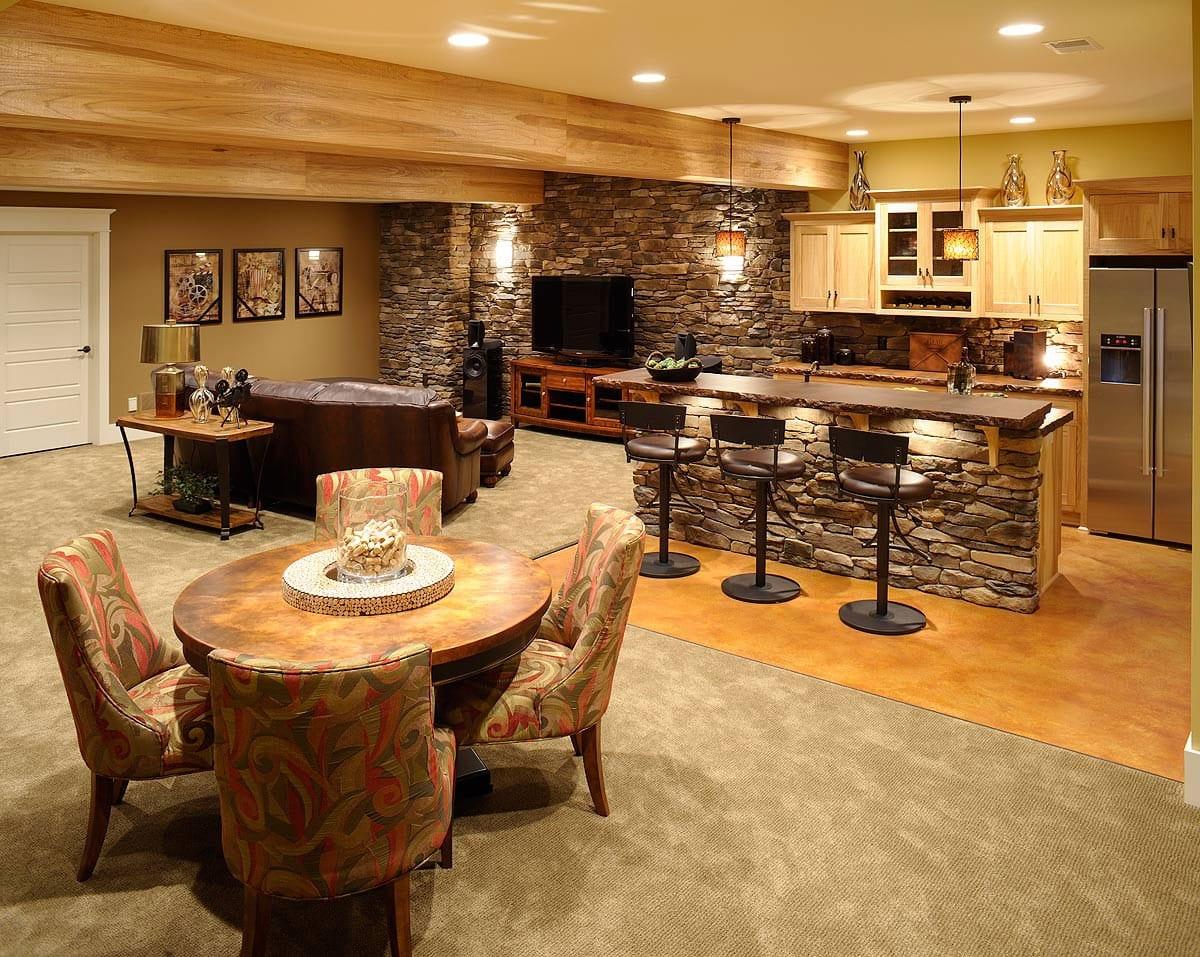 kellerraum als wohnzimmer mit kleiner Küche und Bar aus Naturstein modern einrichten