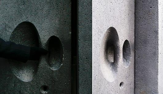 massive steintür aus basalt als idee für moderne ziegelfassade mit eingangstür aus naturstein