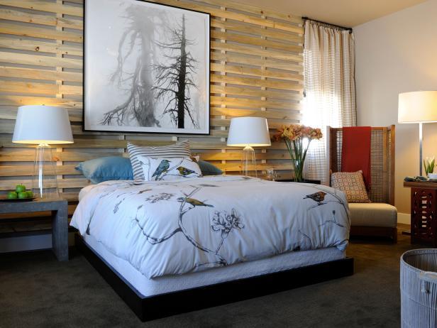 moderne schlafzimmer mit bettgestell schwarz und coole schwarz-weißes baumbild als moderne wanddeko