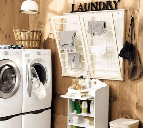 interessante Waschküche einrichtung mit wand-kleiderständer und holzwandverkleidung
