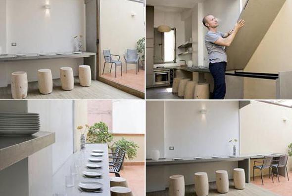 modernes Interior und moderne wohn-esszimmer mit esstisch aus beton entlag der wand und runden hockern aus holz