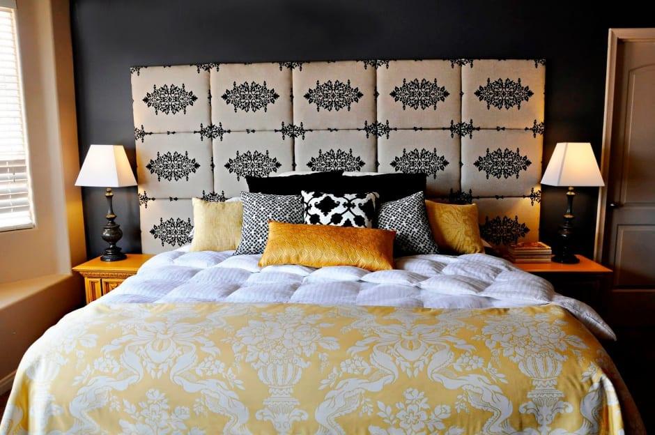 kleine schlafzimmer gestaltung mit gelben nachttischen aus holz und schwarze wand mit kopfteil aus textil_bett dekorieren mit bettdecke gelb und schwarzen kissen