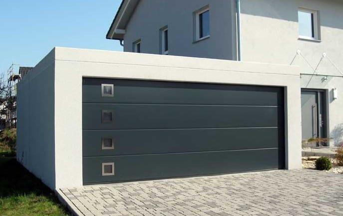 moderne fertig betongaragen als doppelgarage mit Sektionaltor schwarz
