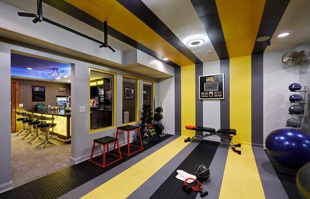 partyraum keller und fitnessraum einrichten im keller_wand streichen idee in gelb und grau