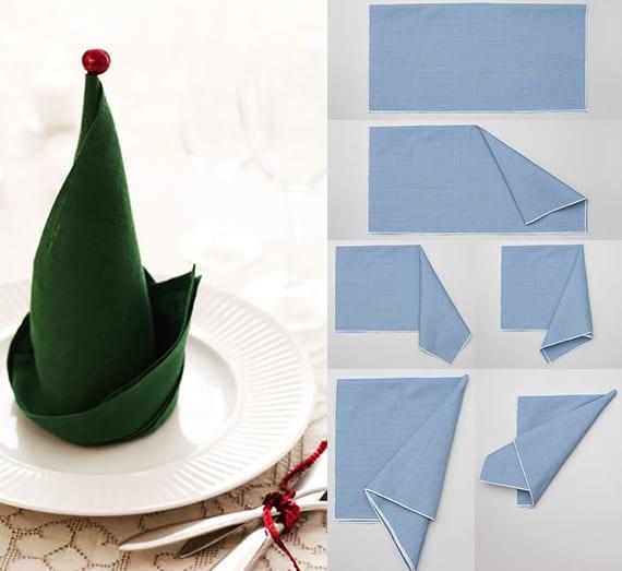 servietten falten als elfenhut aus grünnen stoffservietten für festliche tischdeko zu weihnachten