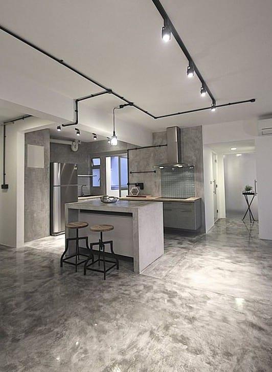 loft wohnung im industrial chiy style modern gestalten mit estrich als bodenbelag und schwarzer deckenleitung mit uchten