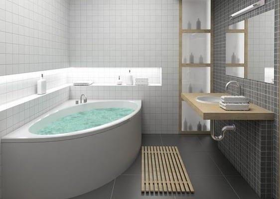 moderne eckbadewanne für kleine badezimmer und wandnische als platzsparende idee für aufstellfläche mit indirekter beleuchtung für kleines bad