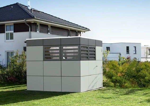 modernes gartenhaus in grau aus paneelen für moderne gartengestaltung