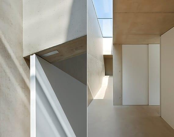 modernes haus aus beton mit glasdach und moderne Schiebe- und Drehtüren weiß