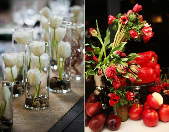elegante und raffinierte blumendeko hochzeit in rot und weiß_tulpen arrangieren in glasvasen mit steinen oder mit rotfarbigen paprikas und äpfeln