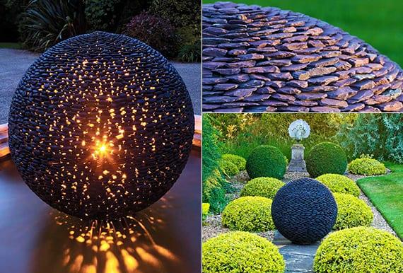 fantastische garten ideen mit großen gartenkugeln aus schwarzen steinen
