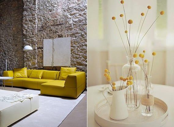 das moderne wohnzimmer in weiß mit mauerwand, poliertem betonfußboden und ledesofa gelb mit leder hocker und weiße tischdeko mit gelben blumen