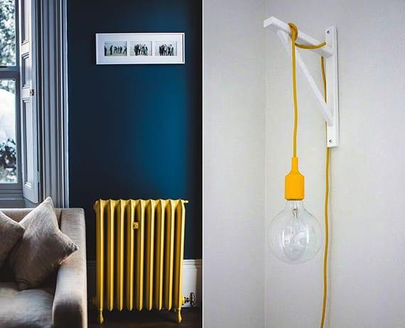 wohnzimmer gestalten mit wandfarbe dunkelblau, sofa in grau und gelbem heizkörper oder weißes wohnzimmer mit gelben pendellampen erfrischen
