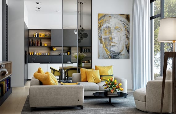 modernes wohnzimmer mit ecksofa grau mit gelben kissen und schiebeglastüren zur küche in schwarzweiß