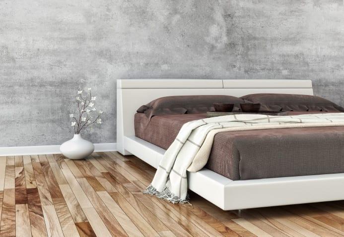 schlafzimmer idee mit modernem bett weiß aus leder,parkett und wandgestaltung in betonoptik
