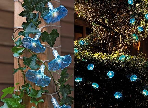 gartengestaltung und gartendeko idee mit dekorativen blumen und blumen-solarlichtern