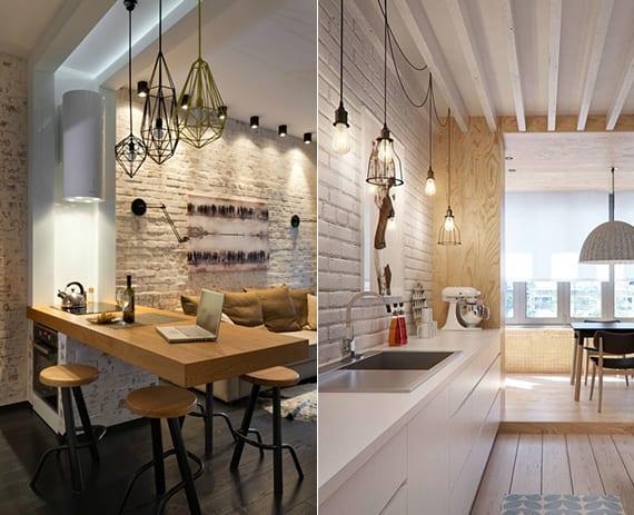 coole lichtkonzepte für wohnküchen mit modernen und vintage-pendelleuchten über arbeitsfläche und esstisch_moderne einrichtungsideen für wohnküchen in kleinen wohnungen mit ziegelwand und holzfußboden