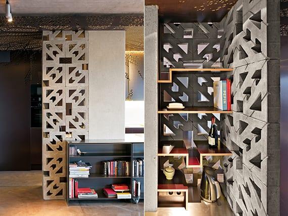 modernes interior design einer loft wohnung mit grauen betonblöcken und schwarzen metallregalen und hängedecke aus metall_coole idee für küche schwarz