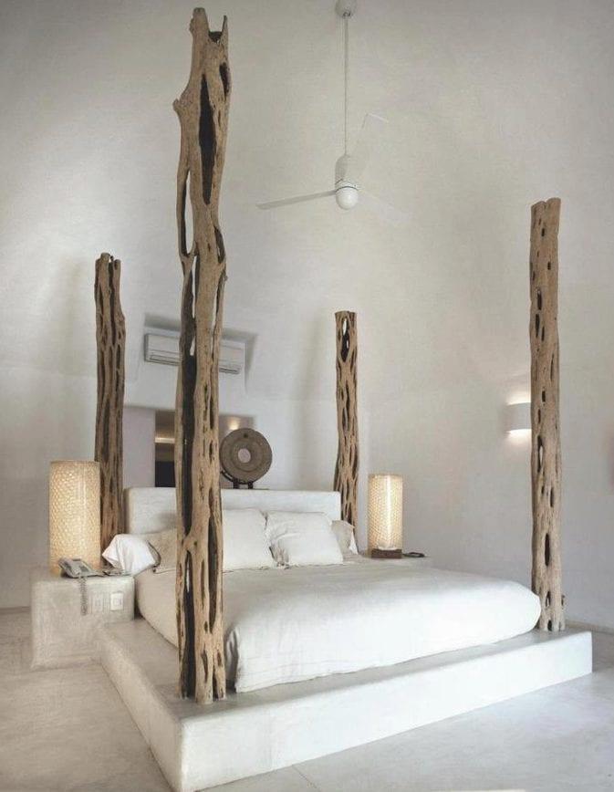 kreatives schlafzimmer design mit ausgemauertem bett mit nachttischen aus beton,pylonen aus treibholz und runden nachttischlampen weiß