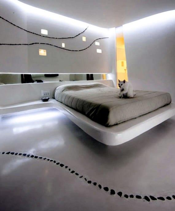 modernes schlafzimmer design in beton mit ausgemauertem schwebebett und spiegelband