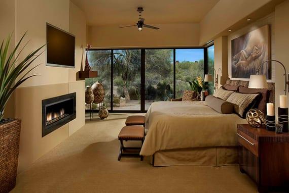african-interior-design-fuer-eine-reizende-schlafzimmergestaltung-mit-in-die-wand-eingebautem-kamin