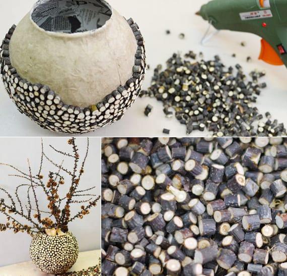 diy vase aus Kugel-Lampe und kleingeschnittenen zweigen