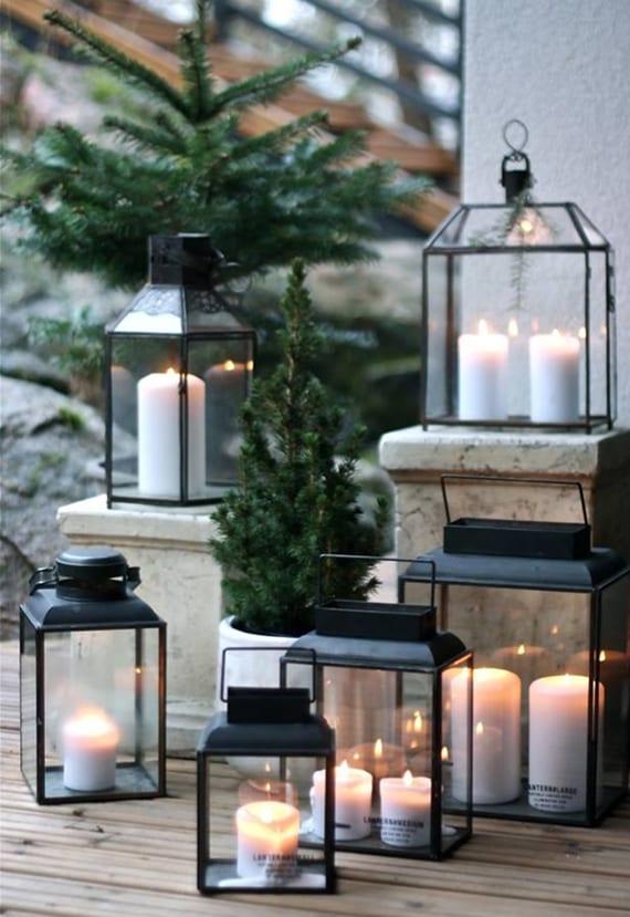 romantische terrassengestaltung im winter mit kerzen und laternen