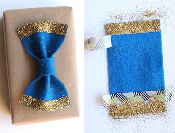 männergeschenke verpacken kreativ mit baluer Filz-Fliege und goldenem Glitzern