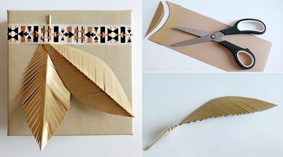 geschenke einpacken in goldpapier und kreativ dekorieren mit diy Federn aus Papier