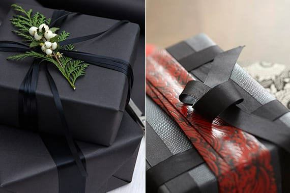 geschenke verpacken weihnachten in schwarzem geschenkpapier mit schwarzem farbband