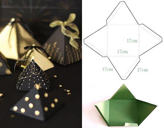 geschenke einpacken in schwarzem pyramide-geschenkbox mit goldenen punkten