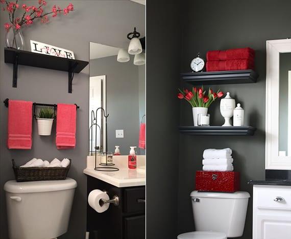 kleines luxusbad gestalten mit wandfarbe grau, wandregalen schwarz, waschtischschrank schwarz und roten hand- und badetüchern