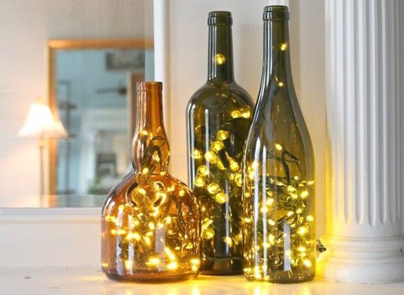 bastelideen für Kamindeko mit DIY Flaschen-Lichtern