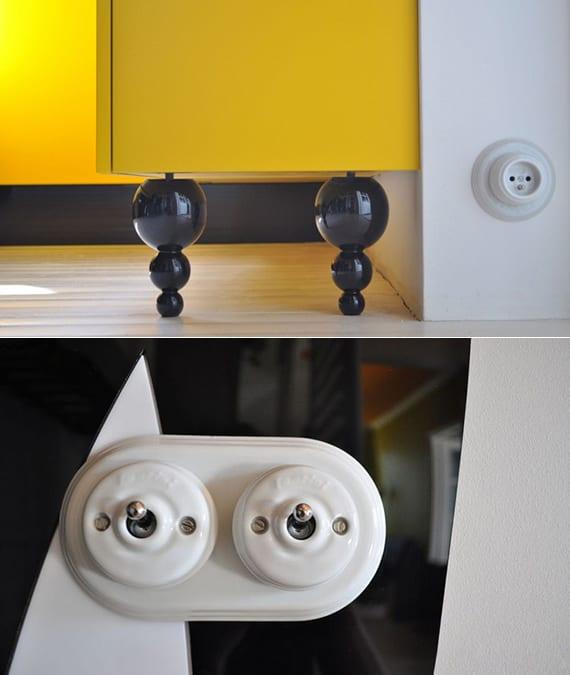 interessante wohnideen für moderne raumgestaltung mit weißem retro-schalter und schwarzen kugel-schrankbeinen