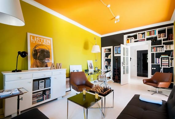 wohnzimmer farbgestaltung mit farbe orange,wandfarben grün und schwarz