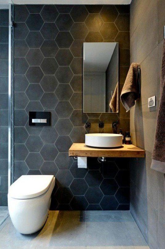 schwarze hexagon-badfliesen für moderne badgestaltung mit weißem wand-WC und rundem aufsatzwaschbecken rund