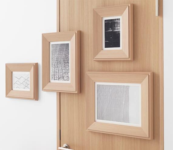 moderne wand- und raumgestaltung durch innovative Holztür mit bilderrahmen aus holz