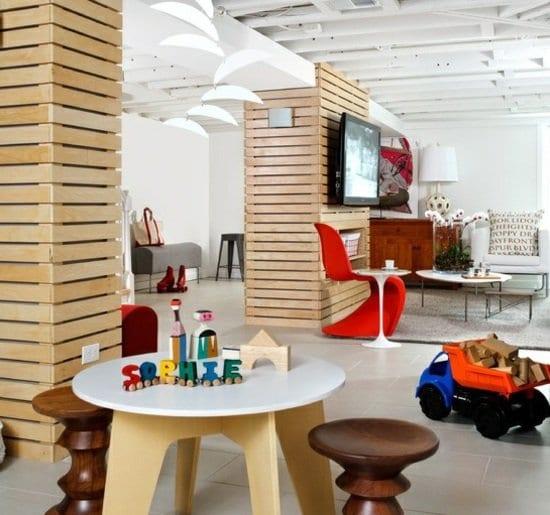 kreative gestaltungsidee für modern eingerichtete Wohnungen mit Designer Möbeln und Wandverkleidung aus paletten