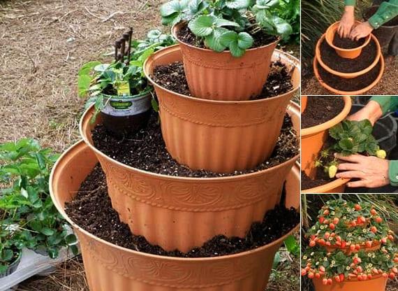 coole gartendeko ideen mit DIY Erdbeereturm aus runden Blumentöpfen