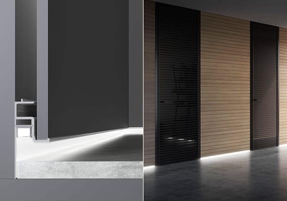 moderne Gestaltung Flur mit Holzwandverkleidung, schwaruen Türen, Natursteinbodenbelag und indirekter Bodenbeleuchtung