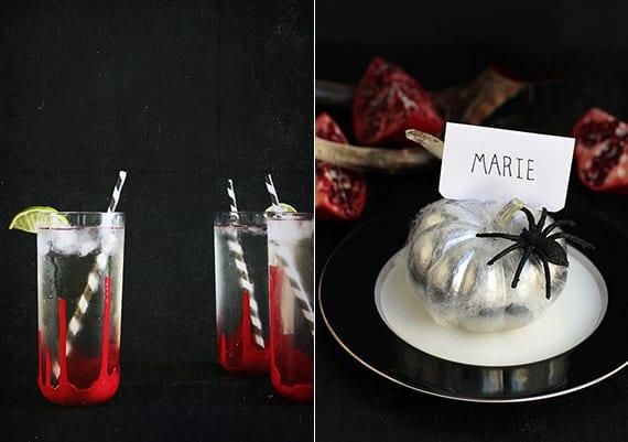 coole halloween partydeko und tischdeko idee mit diy blutigen party-gläser, platztellerdeko mit diy tischkarten aus silbernen kürbissen mit schwarzen spinnen und schwarzen tellern und granatäpfeln auf schwarzer tischdeke